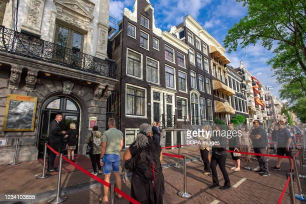 Visitors queue in front of the Royal Theatre Carrë, to pay their last respects to the late TV personality and journalist Peter R. The Royal Theatre...