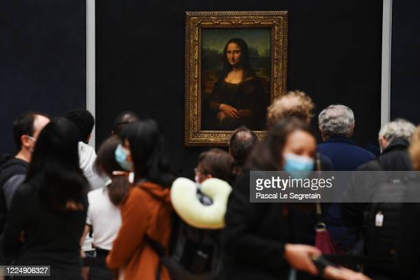 Visitors queue observing social distancing marking to see Leonardo da Vinci's 'Mona Lisa' at the Louvre museum as it reopens its doors following its...