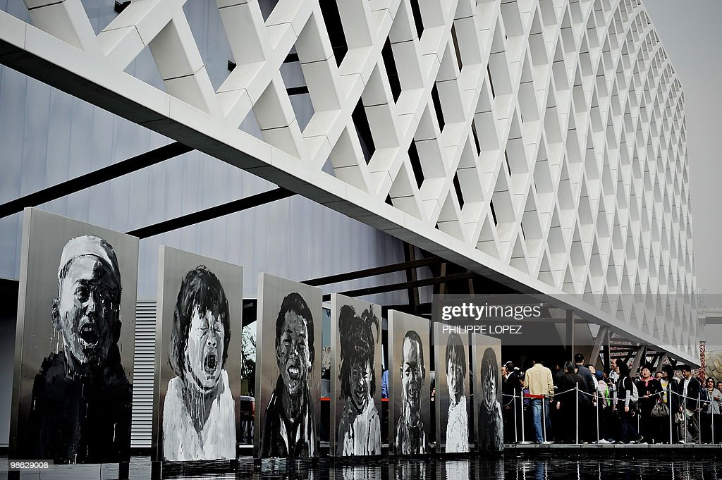 Visitors (R) queue to enter the French pavilion at the site of the World Expo 2010 in Shanghai on April 23, 2010. Expo organisers gave members of the public a preview of the largest-ever World's Fair as they tested facilities and public transportation before the official start on May 1.