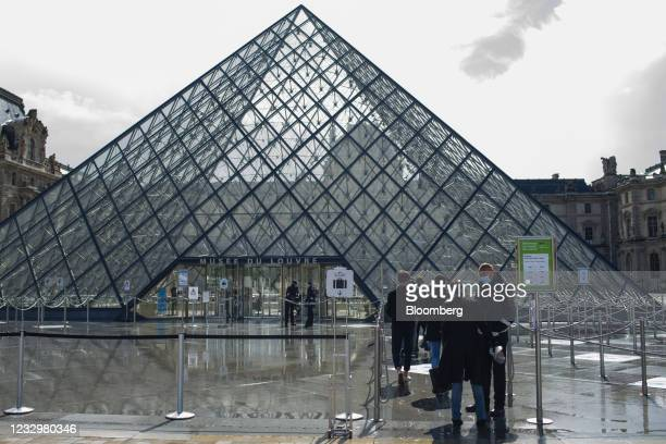 Visitors queue to enter the Louvre Museum in Paris, France, on Wednesday, May 19, 2021.Europe is waking up from the pandemic with cafes in Paris,...