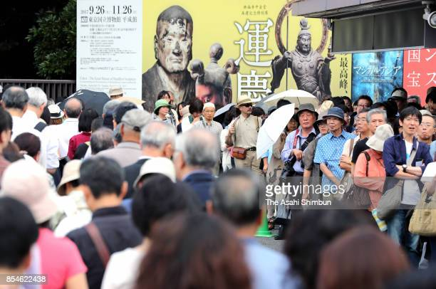Visitors queue to enter the special exhibition 'UnkeiThe Great Master of Buddhist Sculpture' at Tokyo National Museum on September 26 2017 in Tokyo...