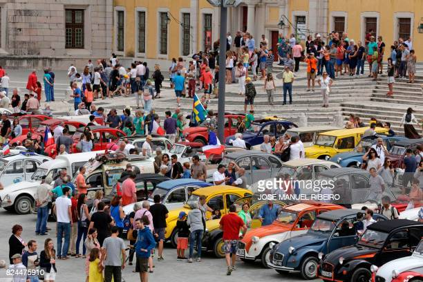 Visitors queue to look at the parked cars in Mafra after the parade of Citroen classic cars 2CV during the World 2017 2CV Meeting July 30, 2017. -...