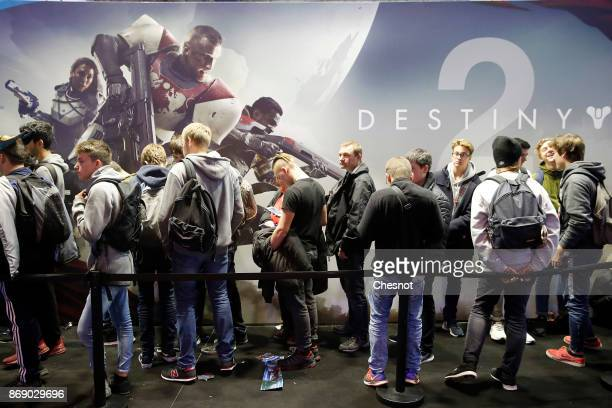 Visitors queue to play the video game 'Destiny 2' developed by Bingie Studios and published by Activision during the 'Paris Games Week' on November...