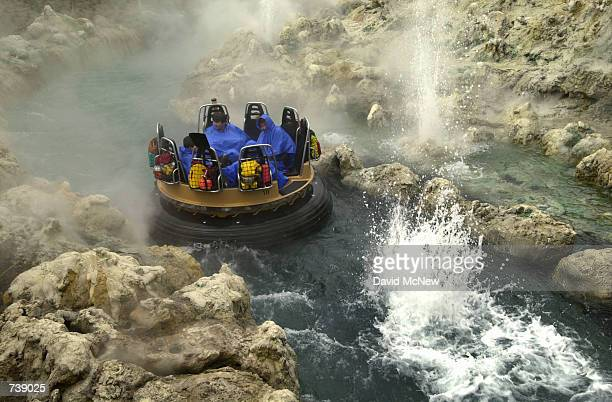 Visitors raft through realistic looking hot springs and geysers on the ''Grizzly River Rapids'' ride during grand opening days of Disney's California...