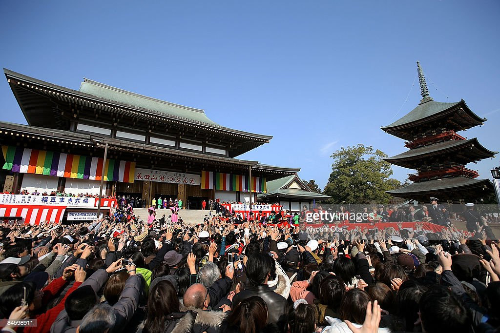 Visitors reach out for the beans thrown by sumo wrestlers, actors and actresses during a bean-scattering ceremony at Shinshoji Temple on February 3, 2009 in Narita, Chiba, Japan. The ceremony is held all over Japan on Setsubun which is the name of the day before the beginning of each season, which in this case is on February 3 or 4, one day before the start of spring according to the Japanese lunar calendar. It has been said that throwing beans drives out misfortune and brings in good luck.
