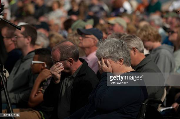 Visitors react to the victims' names being announced at the Flight 93 National Memorial on the 15th Anniversary ceremony of the September 11th...