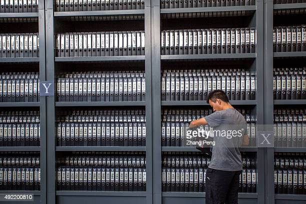 Visitors read the documents of victims in the Nanjing Massacre Memorial Hall located in the southwestern corner of Nanjing On Oct10 UNESCO added...