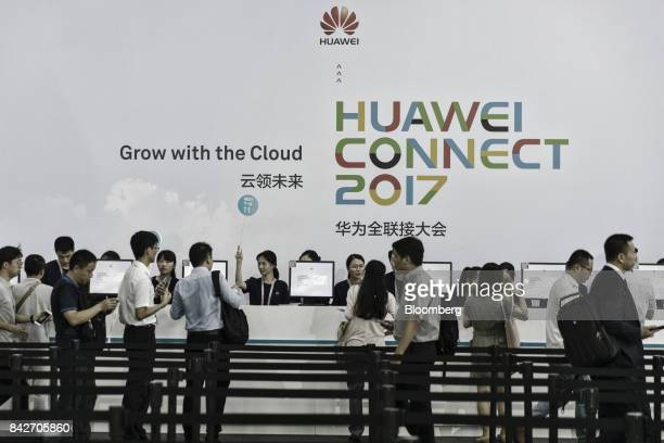 Visitors register at the Huawei Connect 2017 conference in Shanghai China on Tuesday Sept 5 2017 Huawei Technologies Co aims to establish a union of...