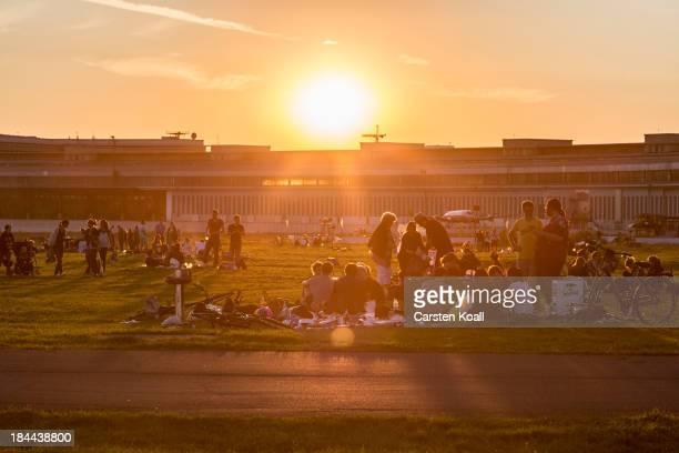 Visitors relax and prepare barbecue at former Tempelhof airport on August 12 2012 in Berlin Germany Tempelhof located in central Berlin was an...