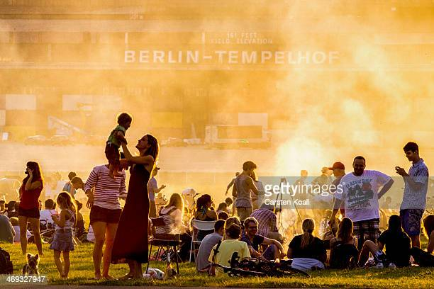 Visitors relax and prepare barbecue at former Tempelhof airport on August 18 2012 in Berlin Germany Tempelhof located in central Berlin was an...