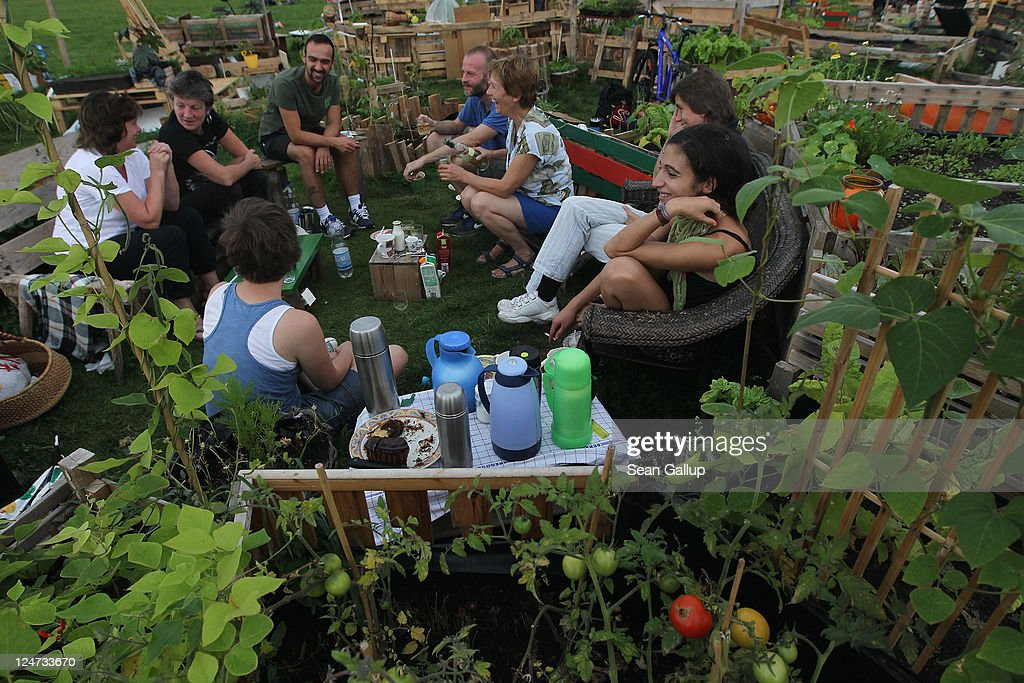 Visitors relax at an urban gardening colony called Allmende Kontor at former Tempelhof airport on September 11, 2011 in Berlin, Germany. Tempelhof, located in central Berlin, was an airport built in the 1930s and is most known for being the main airport used by the Allies in the Berlin Airlift that kept the city and its residents supplied during a blockade by Soviet forces in 1948. The airport closed in 2008 and the grounds were reopened in 2010 as a public park called Tempelhofer Freiheit. City officials are currently considering various proposals for the park's future design that include adding apartment buildings on its outskirts and adding a new subway stop for better access.