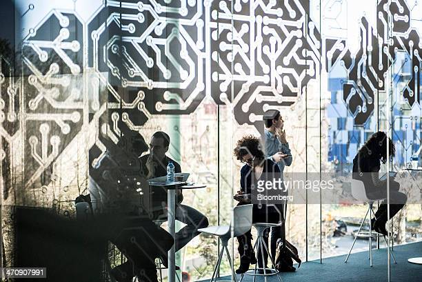 Visitors relax at tables in a rest room at the Barcelona Growth Center in Barcelona Spain on Thursday Feb 20 2014 A smart city initiative which also...