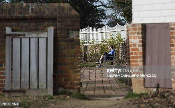 Visitors relax in a garden in Mt Vernon Virginia on December 12 2015 A very mild weather pattern by December standards in the United States has...