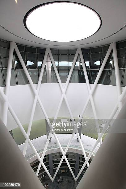 Visitors relax in the main atrium of the ArtScience Museum on February 19 2011 at Marina Bay Sands Singapore The ArtScience Museum opened for the...