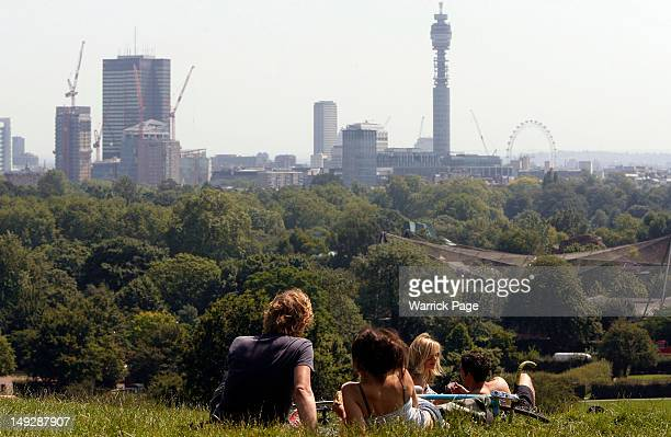 Visitors relax on Primrose Hill on July 26 2012 in London England The South of England continues to enjoy fine weather as the Olympic Games begin...