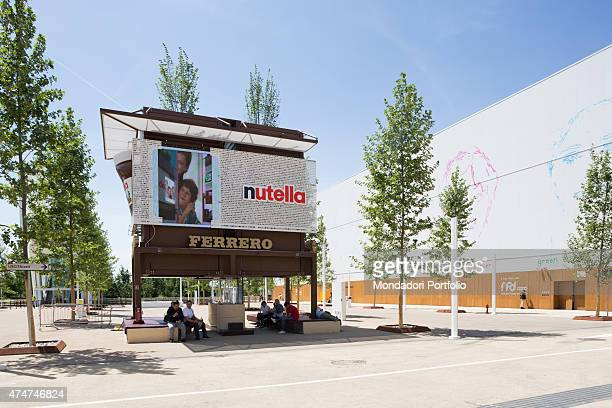 Visitors relaxing under the Nutella and Ferrero advertising sign at Milan Expo ''Feeding the planet Energy for Life'' Milan Italy May 2015
