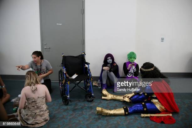 Visitors rest at the San Diego Convention Center during Comic Con International on July 20 2017 in San Diego California Comic Con International is...