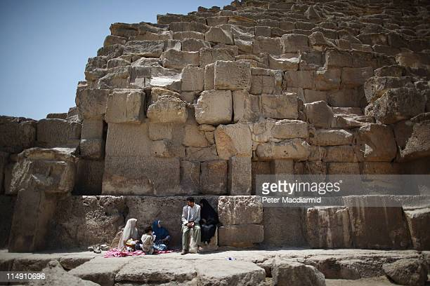 Visitors rest in the shade of the Great Pyramid of Cheops on May 28 2011 in Giza Egypt Protests in January and February brought an end to 30 years of...