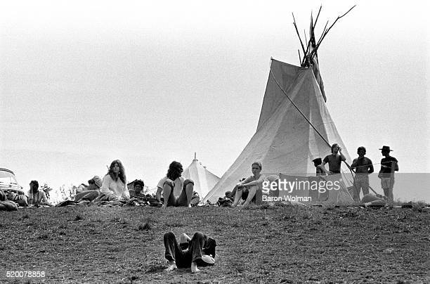 Visitors rest on the grass at the Woodstock Music & Art Fair, Bethel, NY, August 15, 1969.