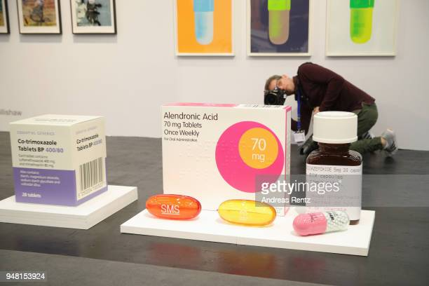Visitors review an artwork of Damien Hirst at Paul Stolper Gallery booth during the Art Cologne exhibition preview at Koelnmesse on April 18 2018 in...