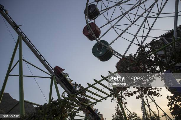 Visitors ride a roller coaster at City Park an amusement park in central Kabul Afghanistan on Friday Oct 27 2017 The Afghan economy is said to grow...