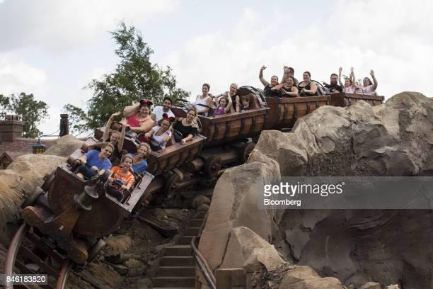Visitors ride a roller coaster at the Walt Disney Co Magic Kingdom park in Orlando Florida US on Tuesday Sept 12 2017 The Walt Disney Co Magic...