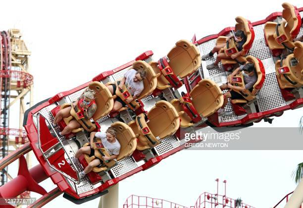 Visitors ride a roller coaster at Universal Studios theme park on the first day of reopening from the coronavirus pandemic on June 5 in Orlando...