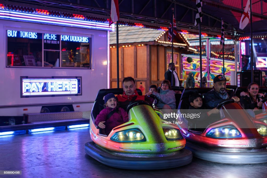 Visitors ride bumper cars at the Nottingham Goose Fair in the Forest Recreation Ground on October 7, 2017 in Nottingham, England. The annual goose fair hosts over 500 attractions for thrill seekers including fun fair classics such as bumper cars, carousels and helter-skelters. The fair is thought to be over 700 years old and its name comes from its origins as a market in the forest grounds where thousands of geese were sold each year.