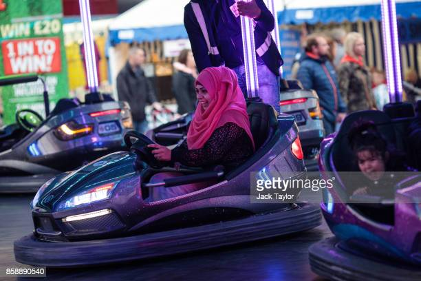 Visitors ride bumper cars at the Nottingham Goose Fair in the Forest Recreation Ground on October 7 2017 in Nottingham England The annual goose fair...