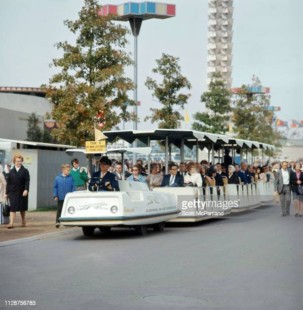 Visitors ride on Greyhound's 'Glide O Ride' shuttle bus in Flushing Meadows Park during the World's Fair in Queens New York New York May 1965