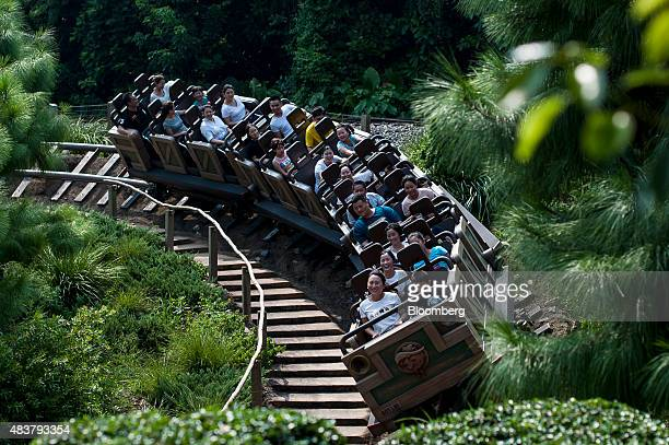 Visitors ride the Big Grizzly Mountain Runaway Mine Cars roller coaster at Walt Disney Co's Disneyland Resort in Hong Kong China on Friday Aug 7 2015...