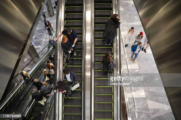 Visitors ride the escalators through 'The Shops' during the grand opening of phase one of the Hudson Yards development on the West Side of Midtown...