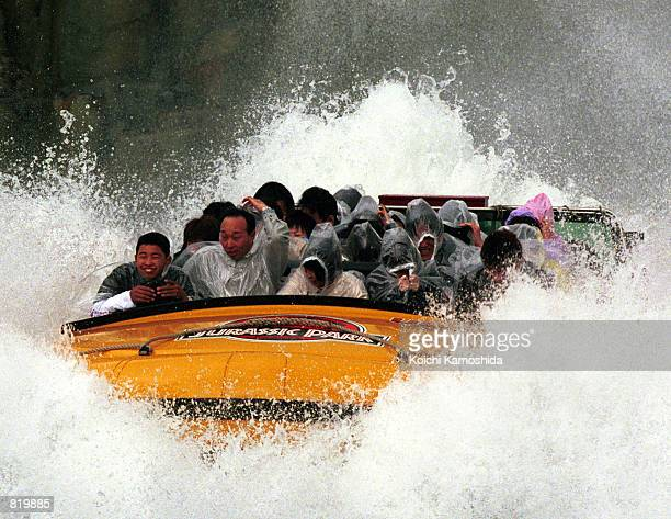 Visitors ride the Jurassic Park themed ride at Universal Studios during the opening day of the park March 31 2001 in Osaka Japan Although the park is...