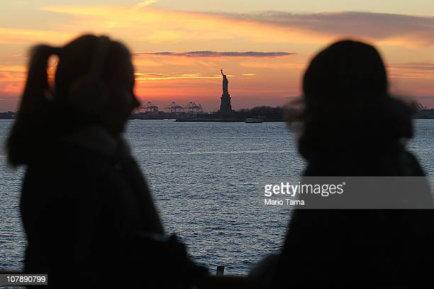 Visitors ride the Staten Island ferry with the Statue of Liberty in the background January 5, 2011 in New York City. In 2010, New York City drew a...