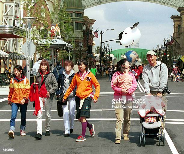 Visitors rush to see the attractions at Universal Studios at its grand opening March 31 2001 in Osaka Japan Although the park is designed to include...