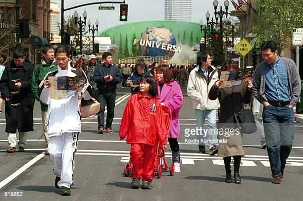 Visitors rush to see the attractions at Universal Studios at the grand opening March 31 2001 in Osaka Japan Although the park is designed to include...