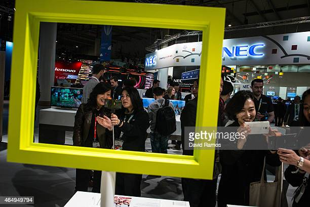 Visitors sample Sony devicces during the first day of the Mobile World Congress 2015 at the Fira Gran Via complex on March 2, 2015 in Barcelona,...