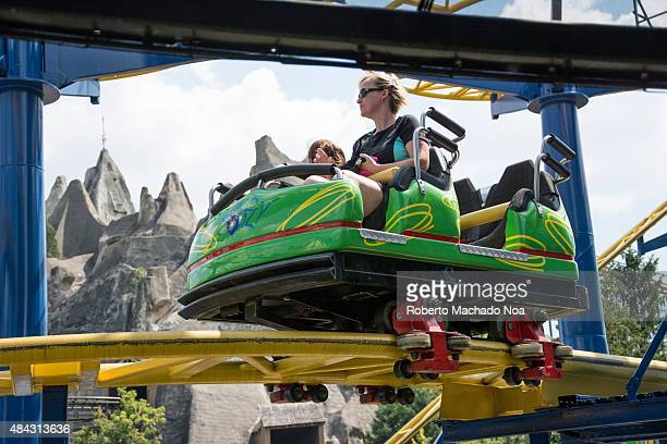 Visitors seated in a roller coaster car in Canada's Wonderland Canada's Wonderland is Canada's largest theme park located in Vaughan Ontario