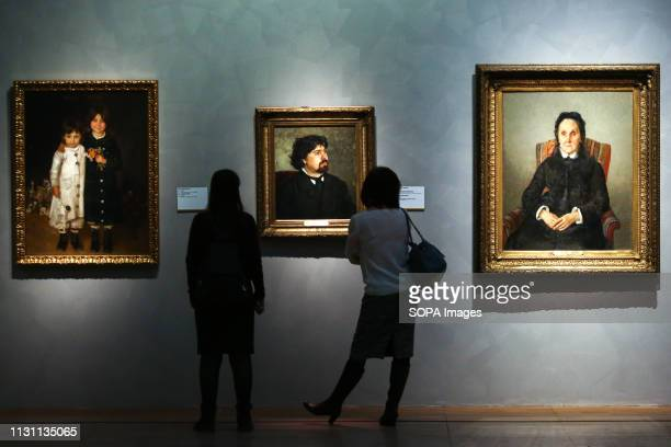 Visitors seen examining the artworks by Ilya Repin during the exhibition Media preview of the exhibition Ilya Repin was held at the New Tretyakov...
