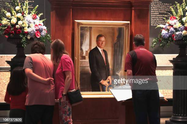 Visitors sign a guest book at the George HW Bush Presidential Library Center on December 1 2018 in College Station Texas Bush who died on November 30...