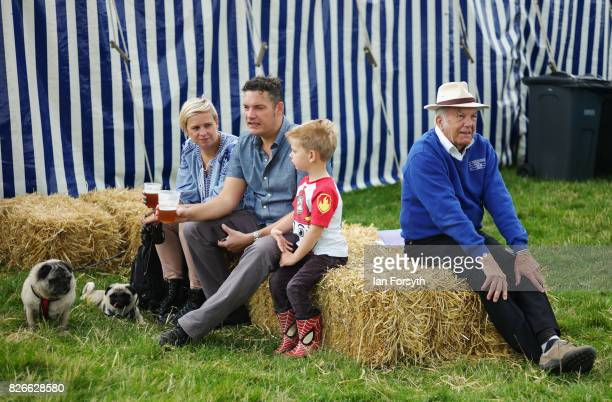 Visitors sit and relax with a drink during the Osmotherley Country Show on August 5, 2017 in Osmotherley, England. The annual show hosts pony, cattle...