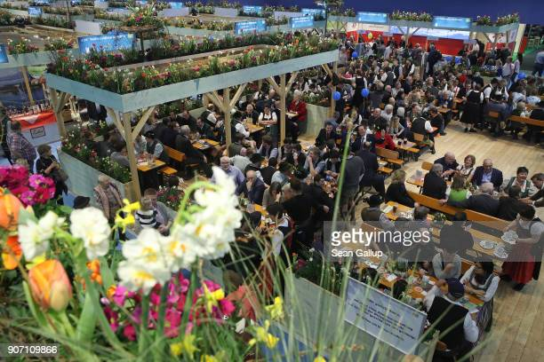 Visitors sit at tables in the Bavaria hall at the 2018 International Green Week agricultural trade fair on January 19 2018 in Berlin Germany The...