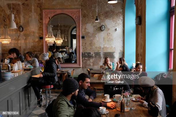Visitors sit in Cafe Letka coffeehouse in Letna district on October 29 2017 in Prague Czech Republic Prague is among Europe's top tourist destinations
