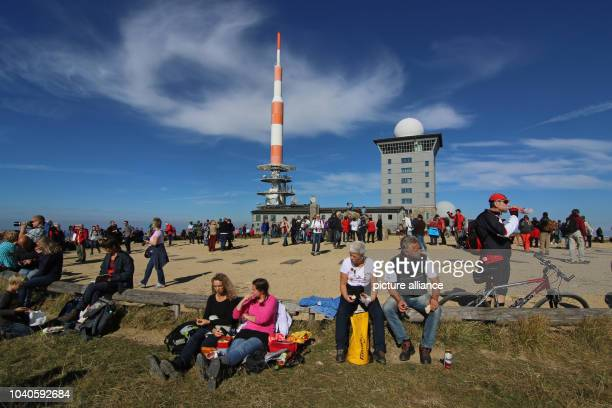Visitors sit in front of a weather station on Brocken mountain Germany 03 October 2015 The Harz Club had arranged an event to celebrate the 25th...