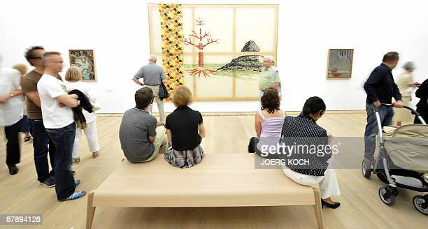 Visitors sit in front of the work Die drei Luegen der Malerei by German artist Sigmar Polke at the Museum Brandhorst in Munich southern Germany...