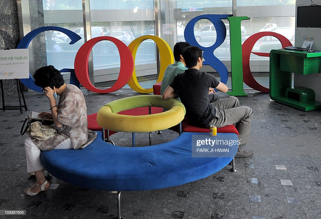 Visitors sit on a bench at a lobby of an : News Photo