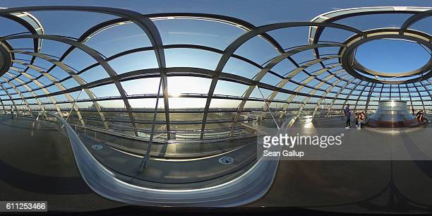Visitors sit on a bench at the very top of cupola of the Reichstag seat of the Bundestag the German parliament on September 27 2016 in Berlin Germany...