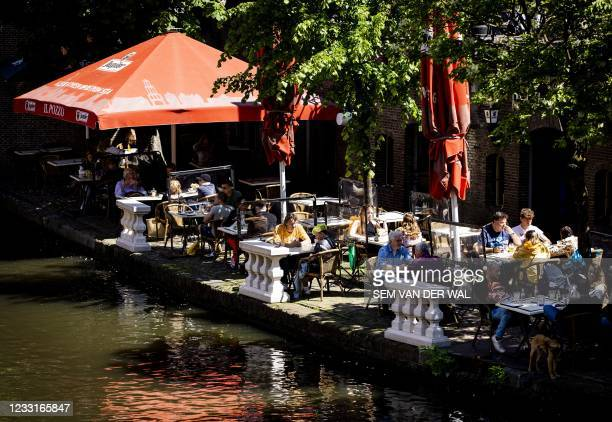 Visitors sit on a terrace in the centre of Utrecht, on May 29, 2021. - Netherlands OUT / Netherlands OUT