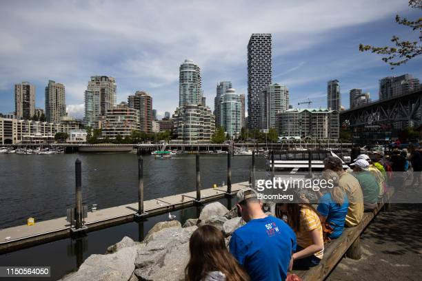 Visitors sit outside the Granville Island Public Market in Vancouver British Columbia Canada on Sunday June 2 2019 Statistics Canada is scheduled to...
