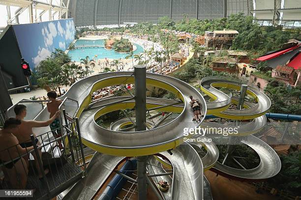 Visitors slide down the water slide at the Tropical Islands indoor resort on February 15 2013 in Krausnick Germany Located on the site of a former...